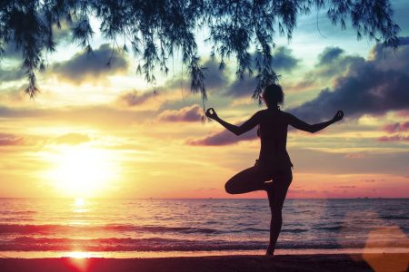 47383839 - yoga and healthy lifestyle. silhouette meditation girl on the background of the sea and sunset.
